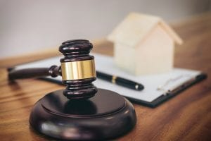 Los Angeles bankruptcy lawyer - Gavel on sounding block at courtroom for decide home insurance Law and justice concept Settle a house dealing lawsuit.